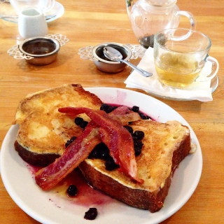 Brioche french toast with streaky bacon, warmed blueberries and maple syrup